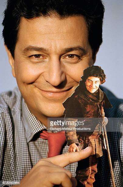 Actor Christian Clavier holds a small a cardboard figure of himself from the 1998 French film Couloirs du Temps Les Visiteurs 2 The film directed by...