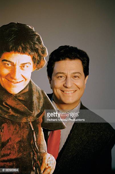 Actor Christian Clavier stands with a cardboard figure of himself from the 1998 French film Couloirs du Temps Les Visiteurs 2 The film directed by...