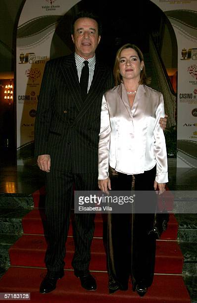 Actor Christian De Sica and his wife Silvia Verdone arrive at the Hotel Billia to attend 'Grolle d'Oro' Italian Movie Awards on March 25 2006 in...