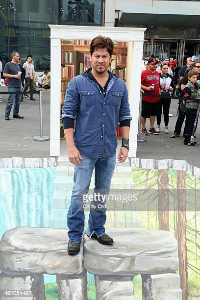 Actor Christian Kane poses at the TNT/TBS The Librarian Season 2 3D street art activation TNT at the New York Comic Con 2015 at the Jacob Javitz...