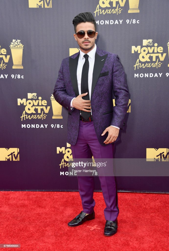 Actor Christian Navarro attends the 2018 MTV Movie And TV Awards at Barker Hangar on June 16, 2018 in Santa Monica, California.