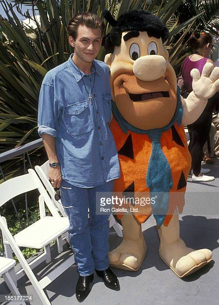 Actor Christian Slater and Fred Flintstone attend the Seventh Annual Celebrity Tennis Classic to Benefit the MakeAWish Foundation on August 10 1991...