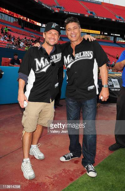 Actor Christian Slater and Steven Bauer attend the Florida Marlins Vs. The Washington National game Super Saturday Concert, before throwing the first...