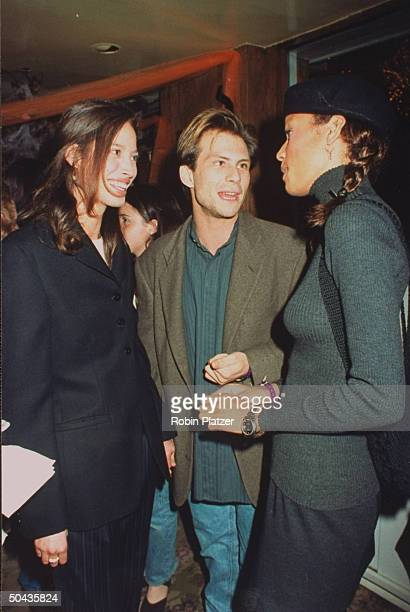 Actor Christian Slater w date model Christy Turlington model Veronica Webb chatting at Halloween on the Green AIDS fundraiser hosted by Magic Johnson...
