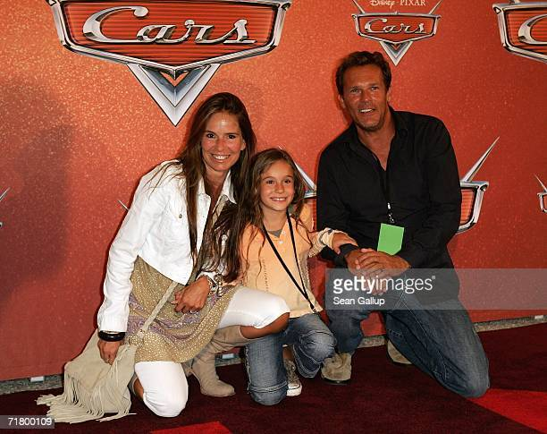 Actor Christian Tramitz his wife Anette Goebel and daughter Lucia arrive for the German premiere of the animated film Cars at a drivein movie theatre...
