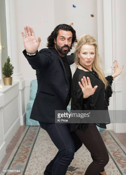 Actor Christian Vit Rhea ElliottJones attend the opening of The Butterfly Terrace painted by Leah Wood at The Mandarin Oriental Hyde Park London on...