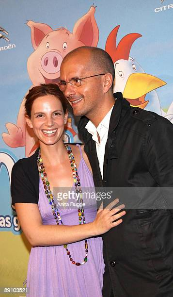 Actor Christoph Maria Herbst and girlfriend Marie Zielcke attend the Berlin premiere of 'Mullewapp' on July 19 2009 in Berlin Germany