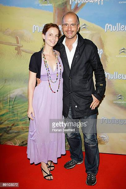 Actor Christoph Maria Herbst and his girlfriend actress Marie Zielcke attend the Berlin premiere of Mullewapp at UCI Kinowelt Colloseum on July 19...