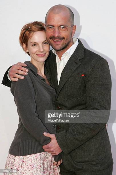 Actor Christoph Maria Herbst and his girlfriend Marie Zielcke pose for photographers during the premiere of the film Haende Weg Von Mississippi at...