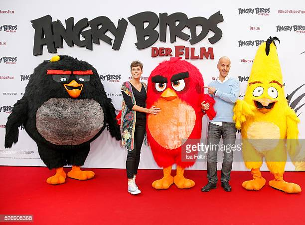 Actor Christoph Maria Herbst and his wife Gisi Herbst attend the Berlin premiere of the film 'Angry Birds Der Film' at CineStar on May 1 2016 in...