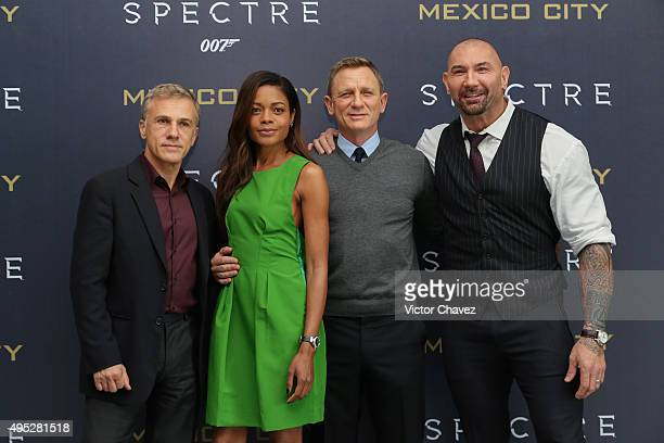 Actor Christoph Waltz actress Naomie Harris and actors Daniel Craig and Dave Bautista attend a photo call to promote the new film Spectre on November...