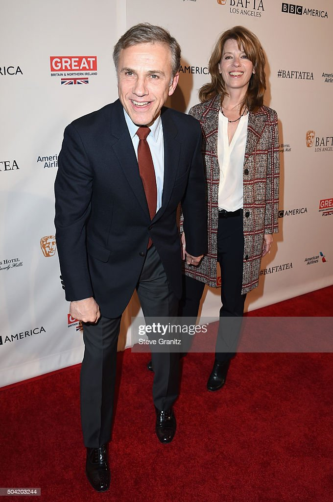 Actor Christoph Waltz (L) and costume designer Judith Holste attend the BAFTA Los Angeles Awards Season Tea at Four Seasons Hotel Los Angeles at Beverly Hills on January 9, 2016 in Los Angeles, California.
