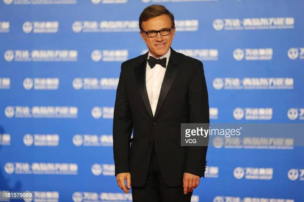Actor Christoph Waltz arrives on the red carpet during the opening night of the Qingdao Oriental Movie Metropolis at Qingdao Beer City on September...