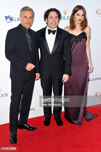 Actor Christoph Waltz conductor Gustavo Dudamel and actress Maria Valverde attend Los Angeles Philharmonic's 2016/17 Opening Night Gala Gershwin and...