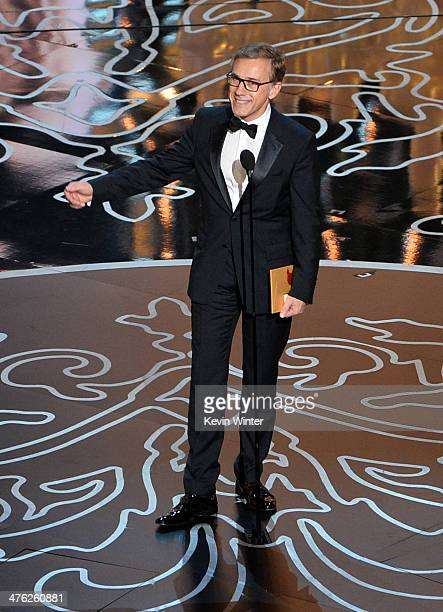 Actor Christoph Waltz speaks onstage during the Oscars at the Dolby Theatre on March 2 2014 in Hollywood California
