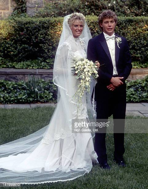 Actor Christopher Atkins and his bride Lyn Barron attend their wedding on May 25 1985 at the Rye Presbyterian Church in Rye New York
