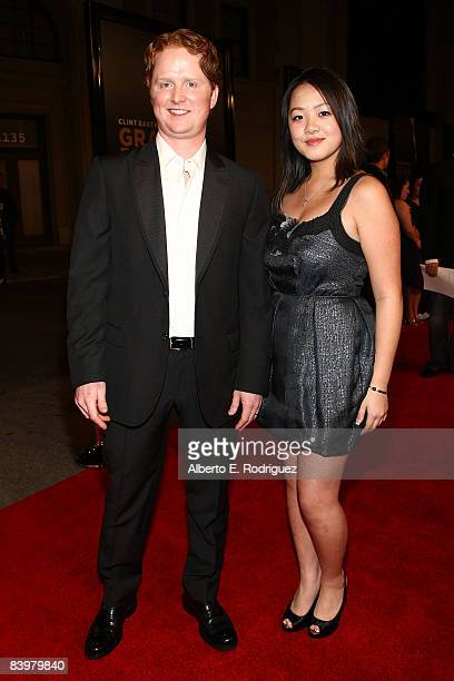 Actor Christopher Carley and actress Ahney Her arrive at the world premiere of Warner Bros Pictures' Gran Torino held at the Warner Bros' Steven Ross...
