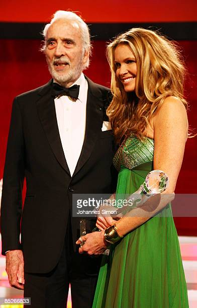 Actor Christopher Lee and model Elle Macpherson pose during the Women's World Awards show on February 5 2009 in Vienna Austria