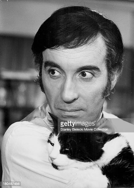 Actor Christopher Lee with a cat in a scene from the movie 'I Monster' 1971