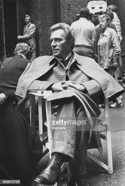 Actor Christopher Plummer wearing his 'Sherlock Holmes' costume as he relaxes during a break in filming 'Murder by Decree' in Clint Street London...