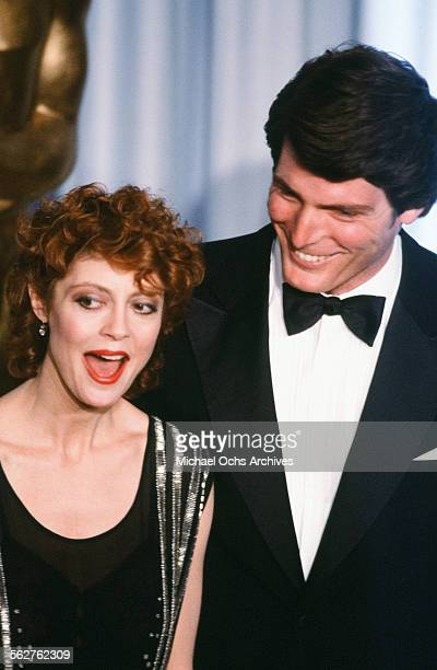 Actor Christopher Reeve and actress Susan Sarandon pose backstage during the 55th Academy Awards at Dorothy Chandler Pavilion Los Angeles California