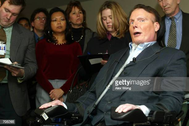 """Actor Christopher Reeve speaks to reporters March 5, 2002 prior to a hearing on """"The Dangers of Cloning and The Promise of Regenerative Medicine""""..."""