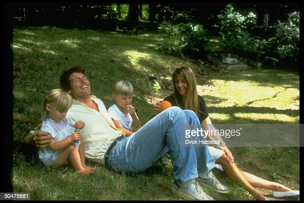 Actor Christopher Reeve w lover Gae Exton their childern Alexandra Matthew relaxing on ground in yard prob at home