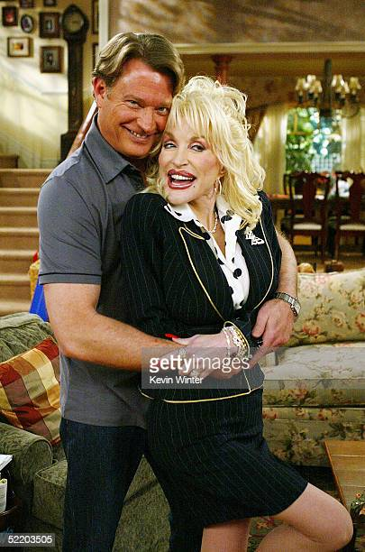 Actor Christopher Rich and singer Dolly Parton pose on the set of The WB's Reba at 20th Century Fox Studios on February 15 2005 in Los Angeles...