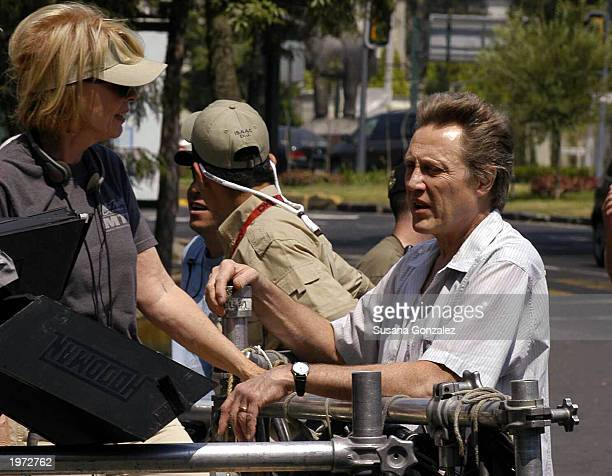 Actor Christopher Walken speaks with an unidentified producer of his new film Man On Fire before filming a scene May 4 2003 in Mexico City Mexico