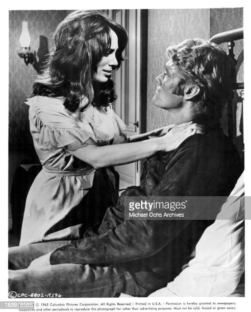 Actor Chuck Connors and actress Kathryn Hays on set of the Columbia Picture movie Ride Beyond Vengeance in 1966