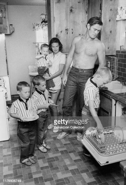 Actor Chuck Connors in the kitchen with his wife Elizabeth Jane Riddell Connors and their four sons Michael Connors Jeffrey Connors Stephen Connors...