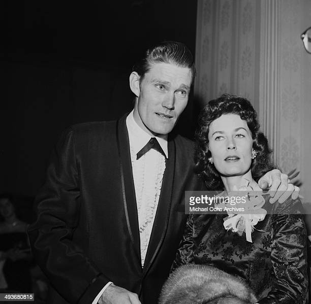 Actor Chuck Connors poses with his wife Elizabeth Riddell in Los Angeles California