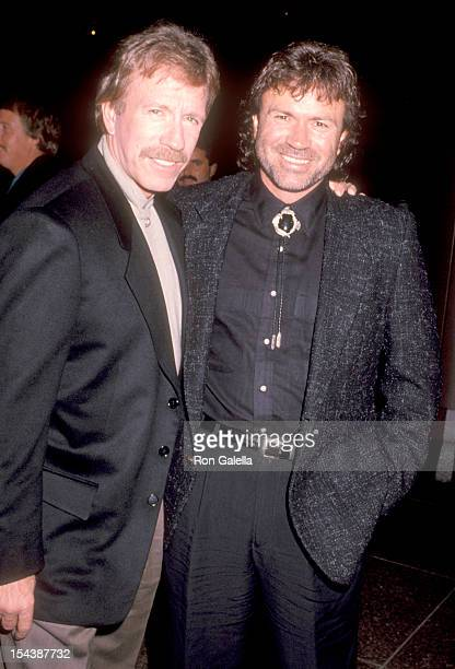 Actor Chuck Norris and brother Aaron Norris attend the Delta Force 2 The Colombian Connection West Hollywood Premiere on August 23 1990 at DGA...
