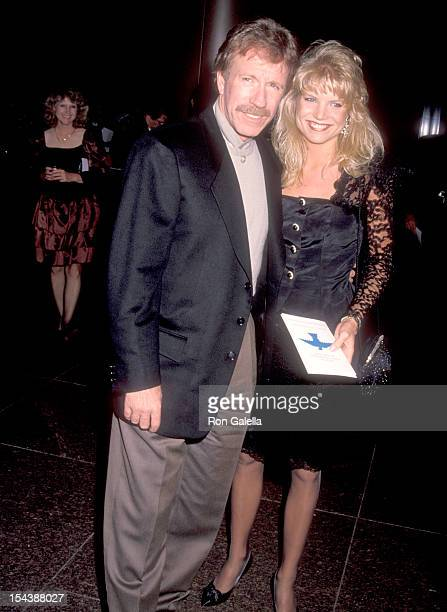 Actor Chuck Norris and date Monica Hall attend the 'Delta Force 2 The Colombian Connection' West Hollywood Premiere on August 23 1990 at DGA Theatre...