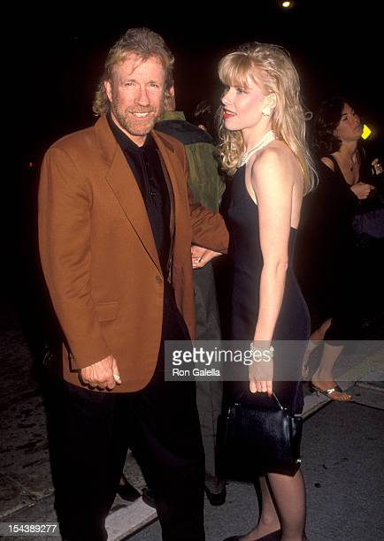 Actor Chuck Norris and date Stephanie Fowler attend Renny Harlin's 33rd Birthday Party on March 12 1992 at Bar One Nightclub in Hollywood California