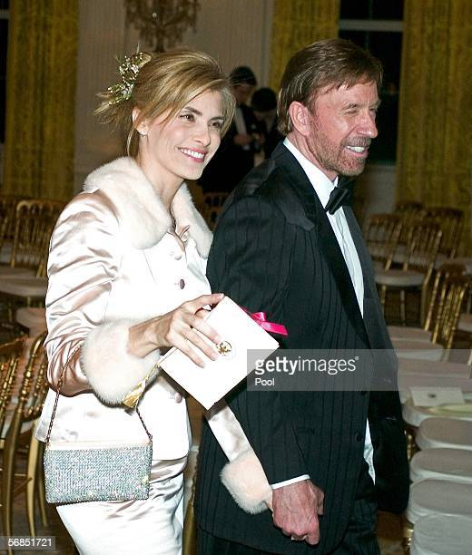 Actor Chuck Norris and his wife Gena O'Kelley depart following a performance by singer Michael Feinstein at a Valentine's Day social dinner in the...