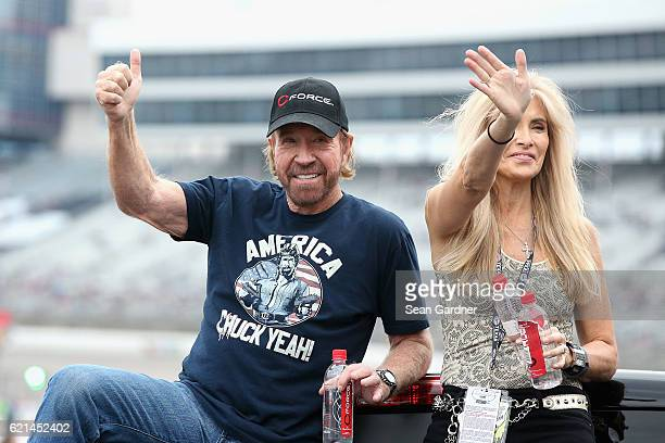 Actor Chuck Norris and his wife Gena O'Kelley wave to fans during driver introductions prior to the NASCAR Sprint Cup Series AAA Texas 500 at Texas...