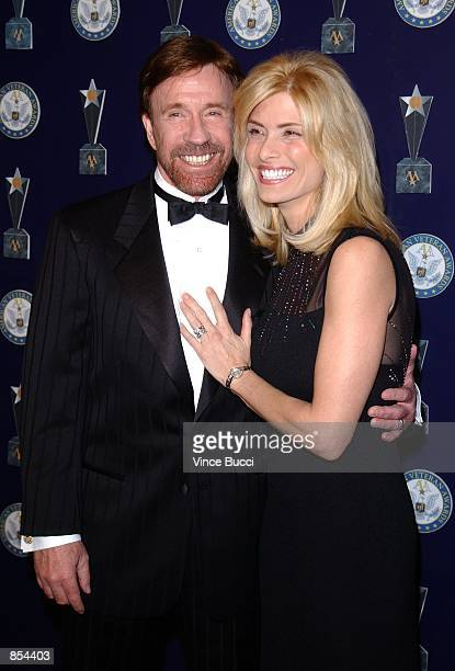 Actor Chuck Norris and wife Gina attend the 7th Annual American Veteran Awards November 30 2001 in Beverly Hills CA The event honored actor Dennis...