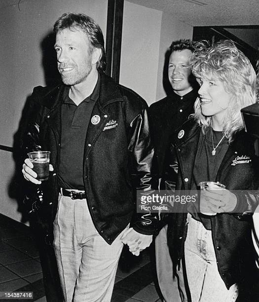 Actor Chuck Norris date Monica Hall and son Eric Norris attend the opening of The Moscow Circus on March 14 1990 at the Forum in Los Angeles...