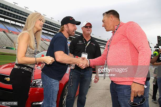 Actor Chuck Norris greets Texas Rangers Manager Jeff Banister as Gena O'Kelley and former Tampa Bay Devil Rays relief pitcher Jim Morris look on...
