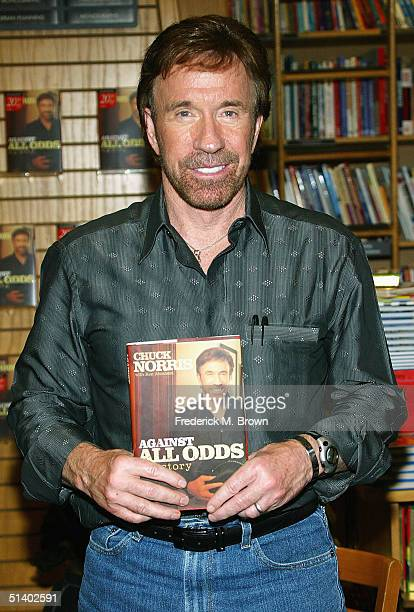 Actor Chuck Norris poses during a book signing for his new book 'Against All Odds' at Borders Books on October 4 2004 in Northridge California
