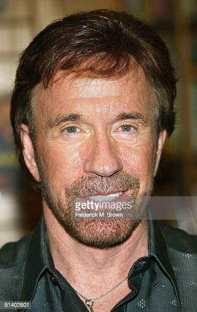 """Actor Chuck Norris poses during a book signing for his new book """"Against All Odds"""" at Borders Books on October 4, 2004 in Northridge, California. ."""