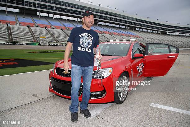 Actor Chuck Norris poses with the AAA Texas 500 pace car prior to the NASCAR Sprint Cup Series AAA Texas 500 at Texas Motor Speedway on November 6...