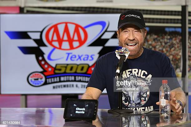 Actor Chuck Norris speaks with the media during a press conference prior to the NASCAR Sprint Cup Series AAA Texas 500 at Texas Motor Speedway on...