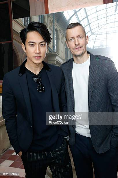 Actor Chung Wu and Lanvin men fashion designer Lucas Ossendrijver attend the Lanvin Menswear Fall/Winter 2015-2016 Show as part of Paris Fashion Week...