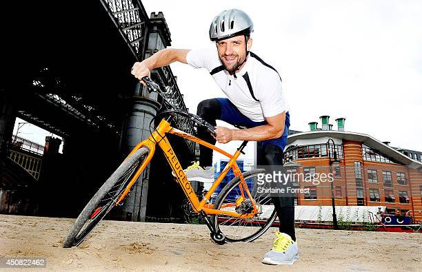 Actor Ciaran Griffiths rides his bicycle with Peugeot for Children In Need on June 18 2014 in Manchester England