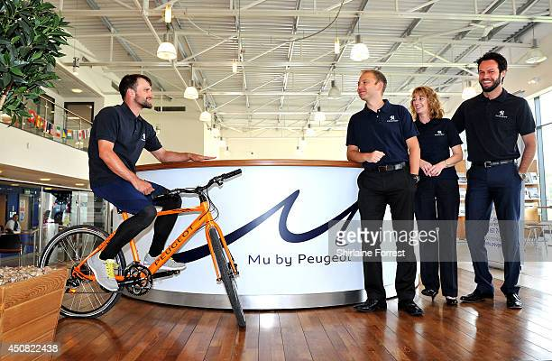 Actor Ciaran Griffiths rides his bicycle with Peugeot staff Shelly Turner Steven Wass and Gareth Pockett for Children In Need on June 18 2014 in...