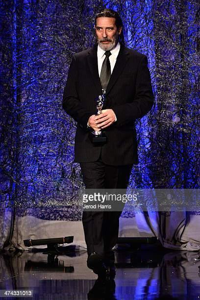 Actor Ciarán Hinds speaks onstage during the 16th Costume Designers Guild Awards with presenting sponsor Lacoste at The Beverly Hilton Hotel on...