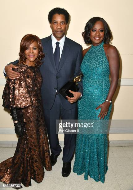 Actor Cicely Tyson honoree Denzel Washington and actor Viola Davis pose with the Hollywood Legacy Award during BET Presents the American Black Film...
