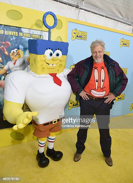 Actor Clancy Brown voice of Mr Krabs poses with SpongeBob as he attends the World Premiere of 'The SpongeBob Movie Sponge Out Of Water 3D' at the AMC...